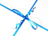 Close-up of a gift box with blue ribbon and bow — Stock Photo