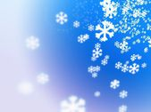 Falling snowflakes on a white-fading blue background — Stock Photo