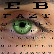 Eye test vision chart with man's face background - Stockfoto