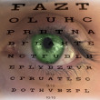 Eye test vision chart with man's face background — Stock Photo #17362407
