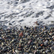 Pebble beach typical of Liguria — Stock Photo