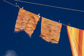 Clothes hanging in the blue sky — Stock Photo