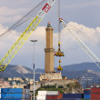The lighthouse of Genoa between two cranes — Stock Photo