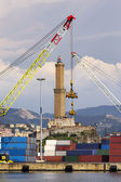 The lighthouse of Genoa between two cranes — Stockfoto