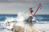 Cranes submerged by the waves — Stock Photo