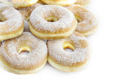 Sugar-coated donuts on white backgro — Stock Photo