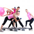 Group of fitness instructors with accesories — Stock Photo