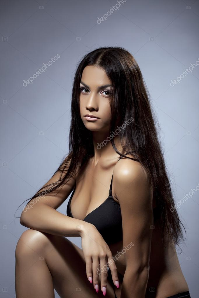 Young gorgeous woman studio portrait in black lingerie — Stock Photo #13265375