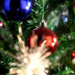 Christmas tree with color balls and bengal sparkler — Stock Video