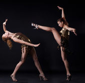 Two girl in gold dance costume posing with fight — Stock Photo