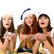 Stock Video: Three girls blow feather on you christmas scene