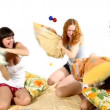 Stock Video: Young girls fight with pillow - christmas scene