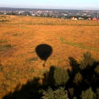 Stock Video: View on autumn field and shadow from balloon