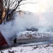 Stock Video: Steam on winter street from water system