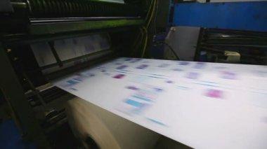 Print shop typography machine work with cmyk newspaper — Stock Video