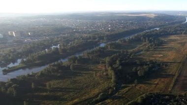 View on plain landscape and river from hot air balloon — Stock Video