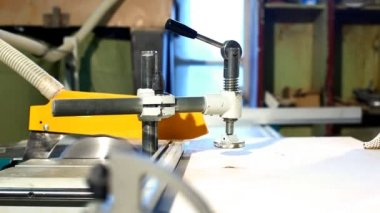 Camera move on frame of plywood circular saw — Stock Video