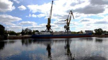 Shipboard cranes and sailing boat — Stock Video