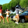 Beauty girls dance hip-hop near car at summer sunset — Video Stock #13460400
