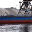 Stock Video: Shipboard crane loaded sand