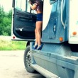 Young girl exit from truck and repair — Stockvideo