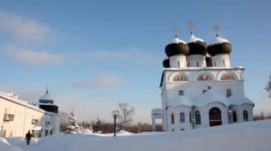 Pan on Christian monastery in winter sunny day — Стоковое видео