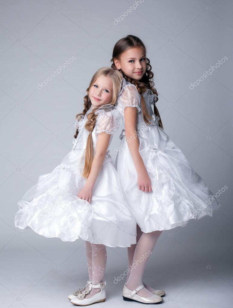 Full length portrait of  little girls in white dresses — Photo #15502703
