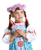 Cute Little girl in slavic costume and wreath — Stock Photo