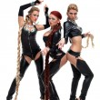 Three dancers in latex bdsm costumes — Stockfoto