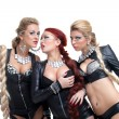 Dancers in black latex costumes show sexual games — Stock Photo