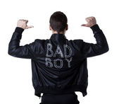 Bad boy portait striptease man in black jacket — Stock Photo