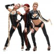 Bdsm dancers in latex costumes with plaits — Stock Photo