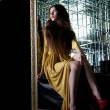 Brunette young woman in long dress - Foto de Stock