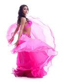 Dancer in pink costume performing oriental dance — Stock Photo