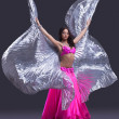Dancer performing oriental dance with wings — Stock Photo