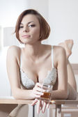 Beautiful woman in lingerie with alcohol drink — Stock Photo