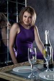 Beautiful woman in purple dress - night restaurant — Stock Photo
