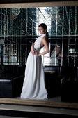 Brunette sexy woman in white dress — ストック写真