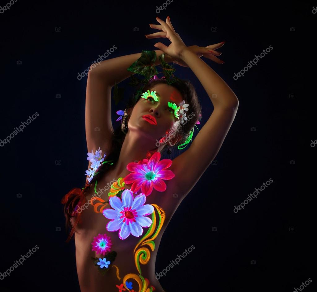 Amazing Woman: Amazing Woman In Glowing Flowers Under Uv Light