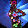 Woman with luminescent body art — Stock Photo