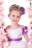Pretty little girl near pink flowers — Stock Photo