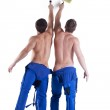 Two sexy painters in blue overalls — Stock Photo #20791579