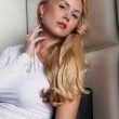 Portrait of attractive young model in white dress — Stock Photo