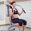 Athletic young woman in gym — Stock Photo