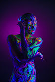 Sexual dancer posing with UV pattern on body — Stock Photo