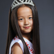 Portrait of cute little girl in precious tiara — Stock Photo #27674867