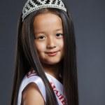 Portrait of cute little girl in precious tiara — Stock Photo