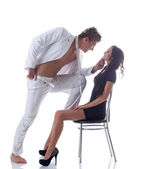 Image of young playful couple posing in studio — Stock Photo