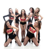 Attractive smiling girls posing in erotic costumes — Stock Photo
