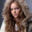 Image of enchanting young girl posing in fur hood — Stock Photo